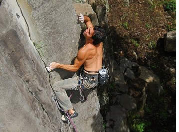 Cesar Melendez at The Ultimate 5.12b, one of the 7 most powerful and technical climbs in Panama (Boquete - Mana sector) Photo: Christian Schrieffer